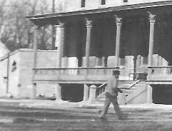 Detail Of Man Crossing Street