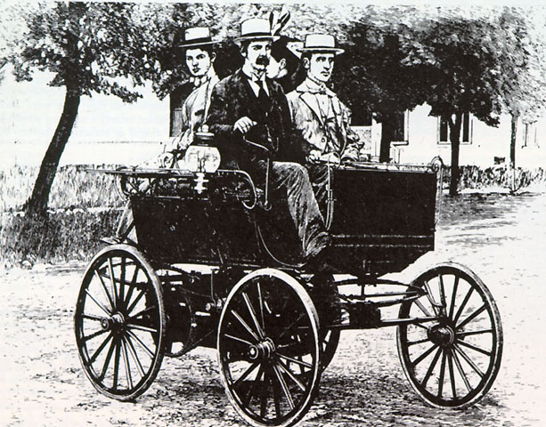In This Engraving Ransom Eli Olds Is At The Tiller Of His First Petrol Ed Car Riding Beside Him Frank G Clark Who Built Body And Back